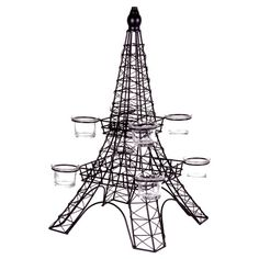 Eiffel Tower-inspired metal tealight holder.    Product: CandleholderConstruction Material: Metal and glass...