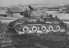 knocked out tank in Kharkov, 1943.  The white powder on the road wheels is the ash from burned rubber that was on the wheels.