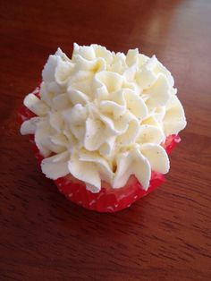 Ruffle/flower/piped cupcake. Made using a wilton 1M tip and buttercream icing.