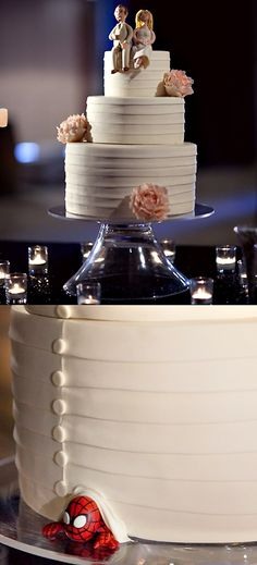 OMG LOVE this wedding cake with a hidden spiderman by studio cake