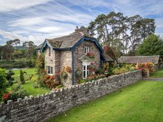 https://flic.kr/p/yH2LJW   A Well-Dressed Cottage, near Crickhowell   On the A40 west of Crickhowell on the River Usk.  It backs onto the Glanusk Estate (or may be part of it) where they have The Green Man music festival.