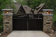 Black Driveway Gate have the stone match the house stone. Make sure it is at least 8ft high to prevent deer from jumping over it.