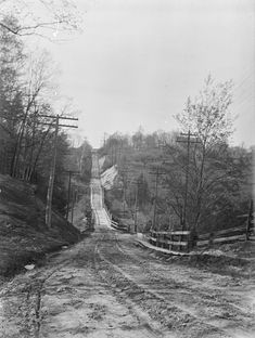 Taken 99 years ago almost to the day (May 8, 1915), this photograph of Forest Hill is attributed to Stuart Logan Thompson (1885-1961). It looks north from the intersection of Bathurst Street and Lonsmount Drive, just north of St. Clair. The wooden bridge and the wooden sidewalks along the dirt road have long been replaced, and the area now has a distinctly residential flavour.