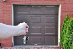 The door to the garage. Opened the garage door remote control , Garage Door Spring Repair, Garage Door Lock, Garage Door Windows, Garage Door Remote Control, Modern Garage Doors, Garage Door Springs, Garage Door Opener, Car Garage, American Garage Door