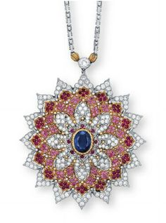 A SAPPHIRE, RUBY, PINK SAPPHIRE AND DIAMOND PENDENT NECKLACE/BROOCH, BY BUCCELLATI, The detachable pendant/brooch set to the centre with an oval-shaped sapphire, within a pierced snowflake surround set with tiers of brilliant-cut diamonds, circular-cut rubies and pink sapphires, mounted in 18k white and yellow gold, pendant/brooch 5.0 cm long, necklace 41.9 cm long, Signed Gianmaria Buccellati, Italy