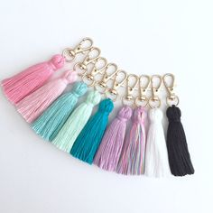 Handmade tiny tassel attached to a gold keychain. Perfect for travelers notebooks or even attach to jewelry. Keychain with tassel measures 3.5