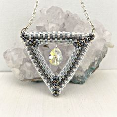 Geometric necklace with Swarovski crystal drop, sterling silver chain and clasp, 46,5cm / 18.3 in long. Triangular necklace. by DecoriBijoux on Etsy https://www.etsy.com/listing/246257856/geometric-necklace-with-swarovski
