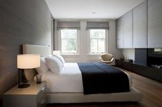 Soft, neutral tones and a graceful Arne Jacobsen Swan chair give this bedroom designed by Callendder Howorth a serene feel.