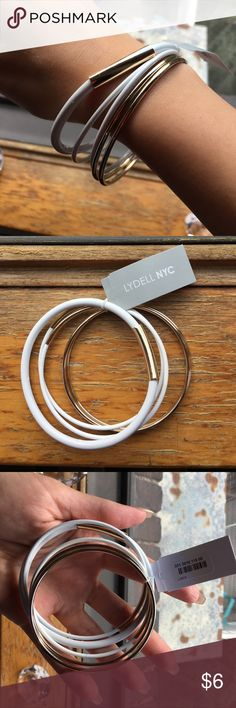 Pack of white bangles Pack of bangels, three white with gold accents, and two gold! lydell nyc Jewelry Bracelets
