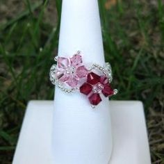 @Overstock - Swarovski crystal and seed beads are woven together by hand to form this flower ring. Very comfortable, this flowery ring can go with nearly everything in its bright pink hues. http://www.overstock.com/Main-Street-Revolution/Crystal-and-Seed-Bead-Floral-Ring-USA/5998323/product.html?CID=214117 $13.99