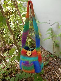 This is a bag that shows off the beauty of self-striping yarns to their best advantage. Knit across, up, and in new directions on this little bag that has the added bonus of a small pocket on each side for a little extra storage.