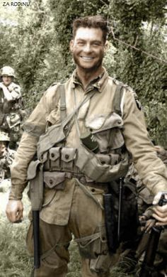 An American soldier France 1944. *Note the German grenade tucked under his ammo belt.