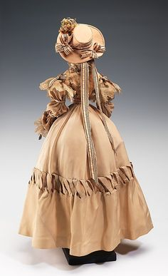 """1828 Doll"" Henriette Beaujeu  (French) Designer: Simone Gange Designer: Gloria Glory Date: 1949 Culture: French Medium: metal, plaster, hair, silk, cotton Dimensions: 32 1/2 x 17 1/2 in. (82.6 x 44.5 cm) Credit Line: Brooklyn Museum Costume Collection at The Metropolitan Museum of Art, Gift of the Brooklyn Museum, 2009; Gift of Syndicat de la Couture de Paris, 1949"