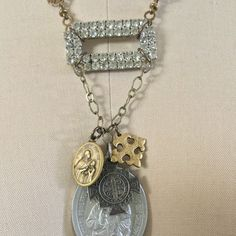 Gorgeous assemblage of vintage religious charms and a charming 1950s rhinestone shoe clip.