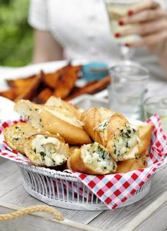 Mozzarella and basil bread: Our favourite garlic bread recipe. Stuff baguettes with mozzarella, basil and garlic, then BBQ or bake for a delicious twist on this family favourite.