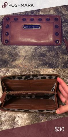 Betsy Johnson Brown Leather Wallet Gently used brown leather Betsy Johnson wallet with cheetah print lining. 8 cars holds, 2 dollar bill holder, id holder and change holder. Betsey Johnson Bags Wallets
