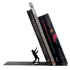 Falling Bookend by Artori Design. Falling bookend supports the books at a surprising, acute angle, which makes it stand out on the shelf and creates interest and humor. Falling bookend supports the books at a surprising, not straight angle. Les Accents, Design3000, Life Hacks, Fallen Book, Book Holders, Book Stands, This Is A Book, Deco Design, Design Shop