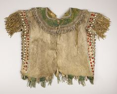 AN APACHE BEADED HIDE SHIRT. . c.1880. ... American Indian ArtWar | Lot #77041 | Heritage Auctions