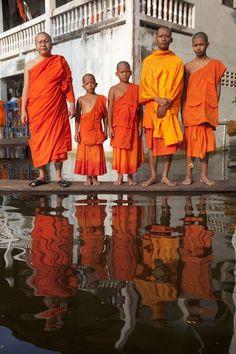 Image by © Gideon Mendel Thailand - 11 Nov 2011, Bangkok Thailand - Floods - Buddhist monks at flooded temple