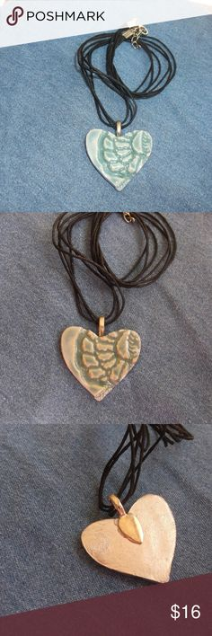 New Peacock Blue Lace Heart Pendant Necklace This is a new handcrafted ceramic heart pendant necklace One of a kind, no two ever alike! Lace design pressed in clay before firing Shiny peacock blue in color with silver on back Fired in my kiln for durability, made from stoneware clay Attached bail, comes with cord necklace, 18 inch cord Approx 1 1/2 inches in size Will come with E Thorp Studios hang card E Thorp Studios Jewelry Necklaces