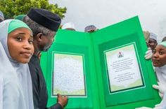 Yemi Osinbajo receives greeting card signed by 2000 students