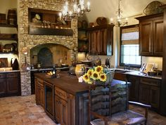 Rustic kitchen with large island and warm wood tones.  #kitchens #kitchendesigns homechanneltv.com