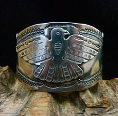 This is an incredible Fred Harvey Era vintage Old Pawn Navajo sterling silver Thunderbird bracelet! Fred Harvey introduced travelers to