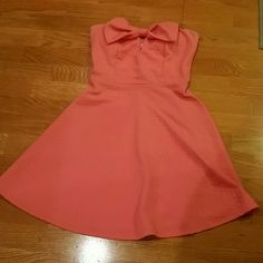 Suoer cute!! Straples dress with cute bow in front Worn once, great condition dress  Beautiful spring color January 7 Dresses Strapless
