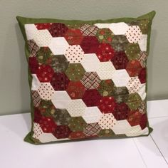 Found on AccuQuilt Quilter's Spotlight! This Half-Hexie Christmas Pillow was cut with the GO! Half Hexagon - Multiple Sizes! Half Hexagons can be pieced in rows so you avoid Y-seams! #accuquilt