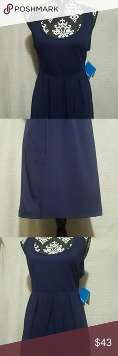 Columbia Marakesh Maven Dress Size XL Brand new with tags.  -Omni-Shade UPF 40 sun protection -Omni-Wick advanced evaporation -Flex Fit -4-way comfort stretch -Multi-functional side pockets, perfect for storing keys or cell phones.   I would say the color of the dress is kind of a navy with a hint of purple. I included a picture of what the dress looks like when someone is wearing it except the dress in that picture is a different color. Columbia Dresses