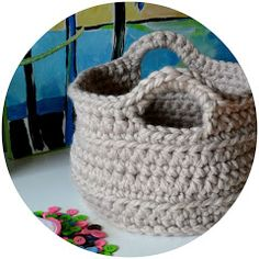 http://crochetincolor.blogspot.com/2012/02/chunky-crocheted-basket-pattern.html