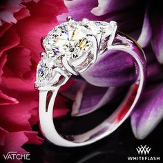 Uniquely beautiful, this Round and Pear 3 Stone Engagement Ring mixes classic styling with a twist. The smooth clean lines rise up to hold two gorgeous Pear Cut Diamonds (G/H VS) that flank a Round Diamond of your choice.