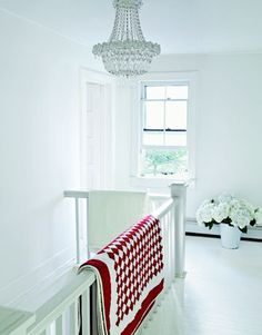Love the red quilt!  It is a nice contrast to all the white.