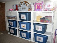 """The Toy Library. Each kid can """"check out"""" 1-2 bins by giving mom the corresponding card and is responsible to clean up the bin they check out before being allowed to check out another. No more messy playrooms! Love this idea!"""