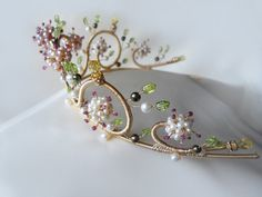 Ruby and pearl multi-gemstone floral motif gold tiara. $600.00, via Etsy.