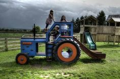 Awesome!! (UK) Side profile with kids (Children's blue wooden tractor with slide)