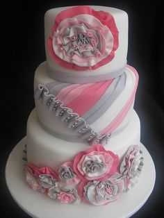 Pink and Gray Ruffles and Rosettes on this cake