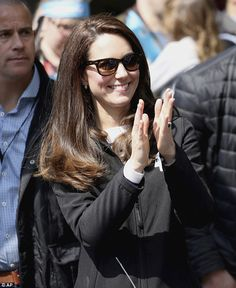 The Duchess donned a pair of Wayfarers at one point as she clapped from the sidelines...