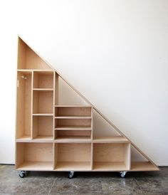 Triangle Compartment Shelf - interesting approach to under stairs storage