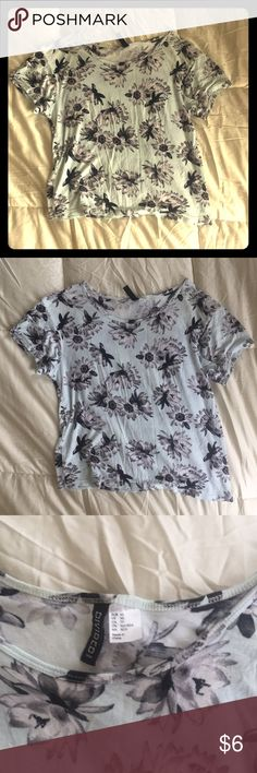 H&M Floral Tee Size XS, light blue base color, greyscale flower design (sunflowers, daisies). Loose-fitting semi cropped cut. Divided Tops Tees - Short Sleeve