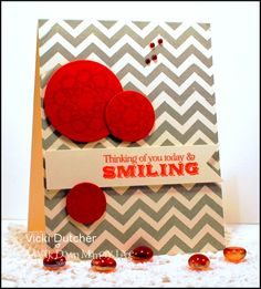A pop of red combined with grey chevron paper make for a simply stunning card.