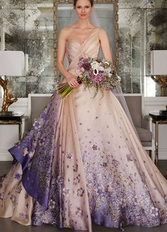 Bridal Fashion Week was a total whirlwind, but after the sequins settled and the tulle subsided, we picked our 9 favorite trends from this season. From layering to shifting hemlines, reinvented sleeve designs to a surprising amount of color, keep reading to see the biggest trends of the season. 1. F