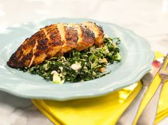 Chicken breasts get a quick, flavorful spice rub and are paired with a super-healthy side of greens and grains.