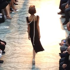 Pearls down the back at Vivienne Westwood's show at #lfw. Photo by the WSJ's Mary Lane.