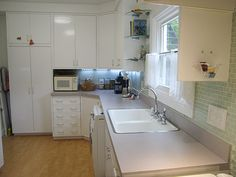 """Steel """"laboratory"""" cabinets used in vintage kitchen remodel"""