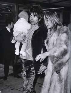 Keith Richards, Anita Pallenberg and their son Marlon at the Heathrow airport, december 1969.