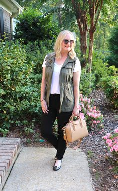 Black White and Olive (Trendy Wednesday #138) - see how a utility vest adds color and texture to an all-neutral outfit: a white tee, blacj jeans, black ballet flats and Givenchy bag.