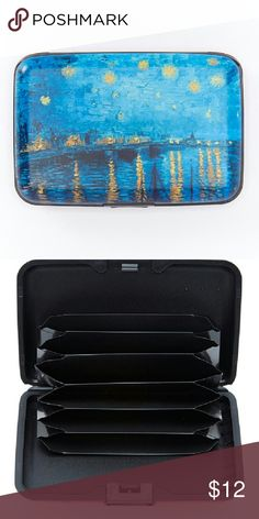 """Blue and yellow Starry River armored wallet Keep your Essentials organized and protected with this trendy wallet featuring an RFID shield and electromagnetic sleeve that Safeguard your personal information. 4.5"""" wide  3 """" high x .5. """"deep. Metal. Snap closure. Standard wallet pockets. Bags Wallets"""
