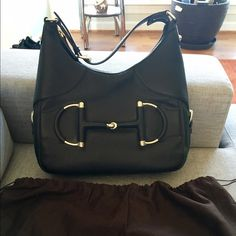 """Gucci black pebbled leather heritage hobo 100% Authentic. Paid just under $3k in 2013. Used 5 times. Like new, perfect condition. Smoke free/pet free home.   Details: black pebbled leather with gold-tone hardware and adjustable shoulder strap. Red and green Gucci web trim at bottom and sides. Zipper closure. Dust bag included. Height 9"""", width 12"""", depth 4"""". Thanks! Gucci Bags Shoulder Bags"""