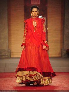 Sonalika Sahay walks the ramp for designer Anju Modi on Day 1 of Delhi Couture Week, held in New Delhi, on July 31, 2013.